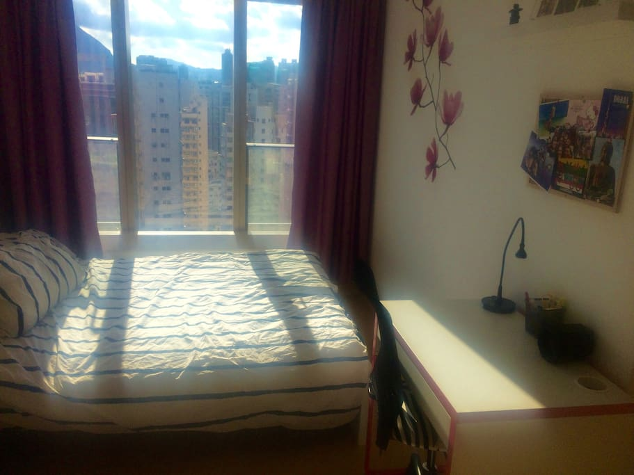 Bedroom with open view and work desk
