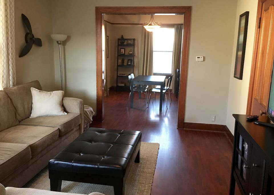 Open family and dining area. Lots of light and several big windows throughout.