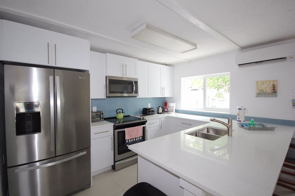 Full equipped Kitchen, all new appliances and granite countertop