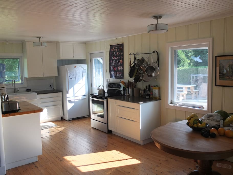 Sun-filled kitchen and dining areas.