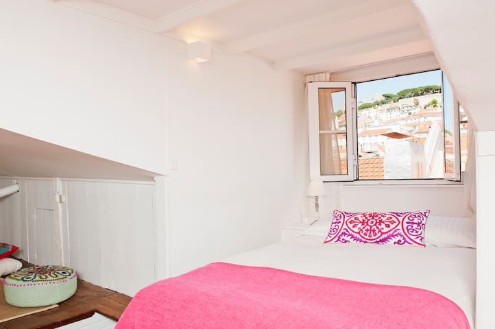 The upper bedroom features a comfortable double bed and a fantastic view over the Castle and downtown's vibrant rooftops