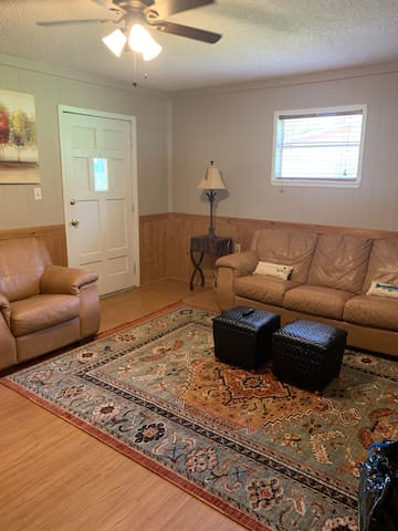 Living room with leather couch and chair