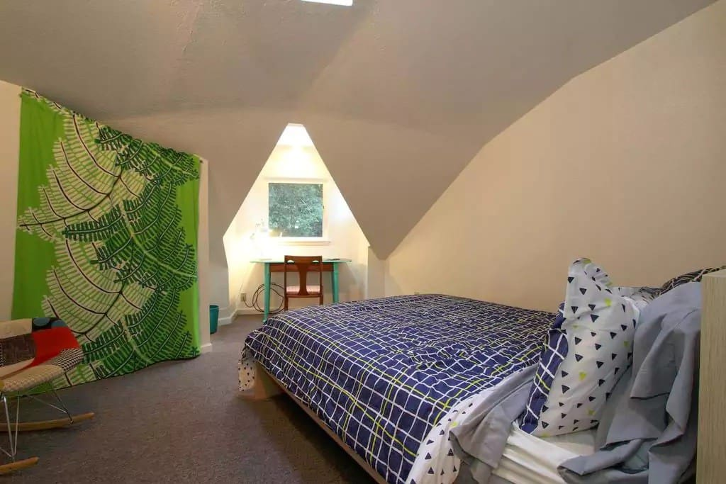The Redwood Loft - Your spacious upstairs bedroom -- complete with a writer's desk and queen-sized Casper bed