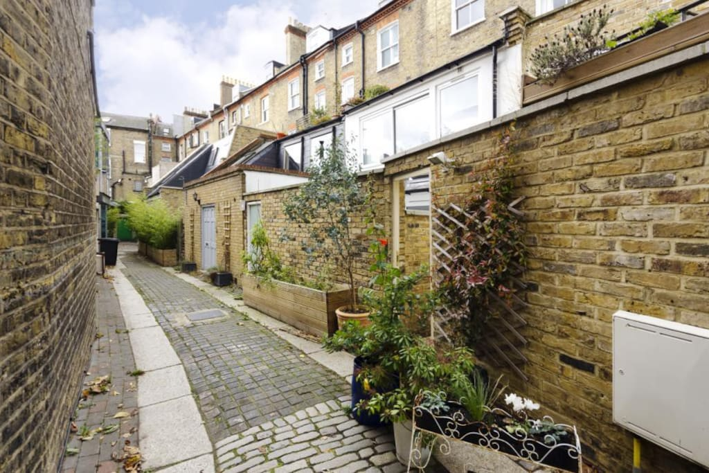 Private Mews approach with gated access