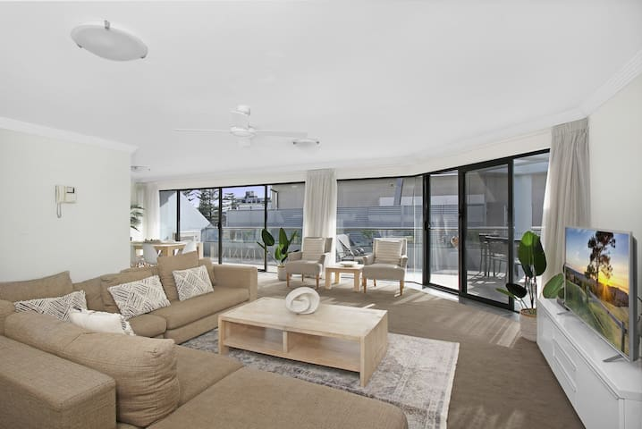 Spacious & open plan living & dining opens to gorgeous terrace with beach views