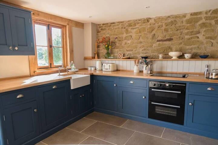 Bespoke fully equipped kitchen, limestone floors and underfloor heating.