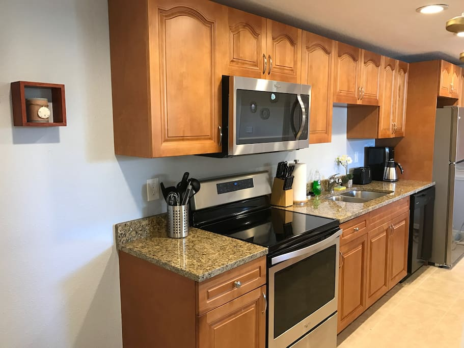 Large kitchen with all amenities - dishwasher, stove, microwave, garbage disposal, coffeemaker.