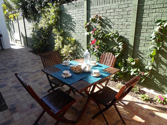Table & chairs for outdoor dining in the private courtyard with access to the BBQ & swimming pool
