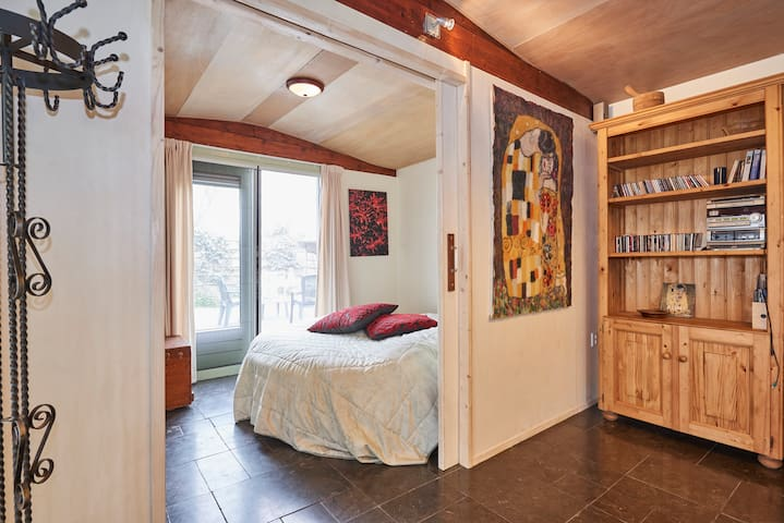 Sliding doors give access to the bedroom