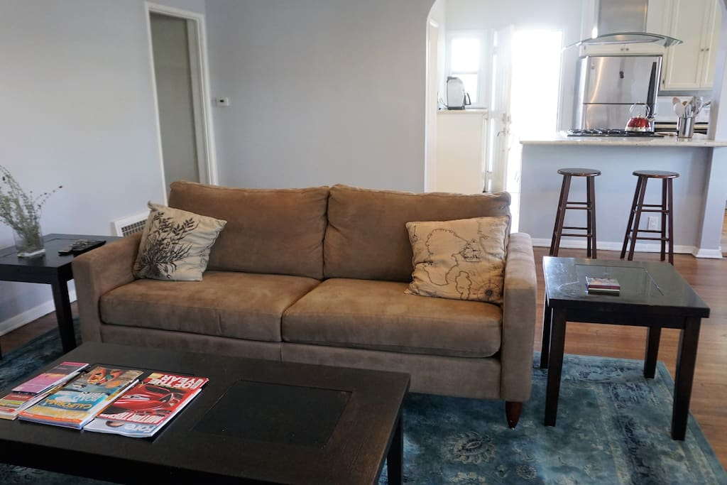 Relax in the comfortable couch while watching TV or reading one of books in the house