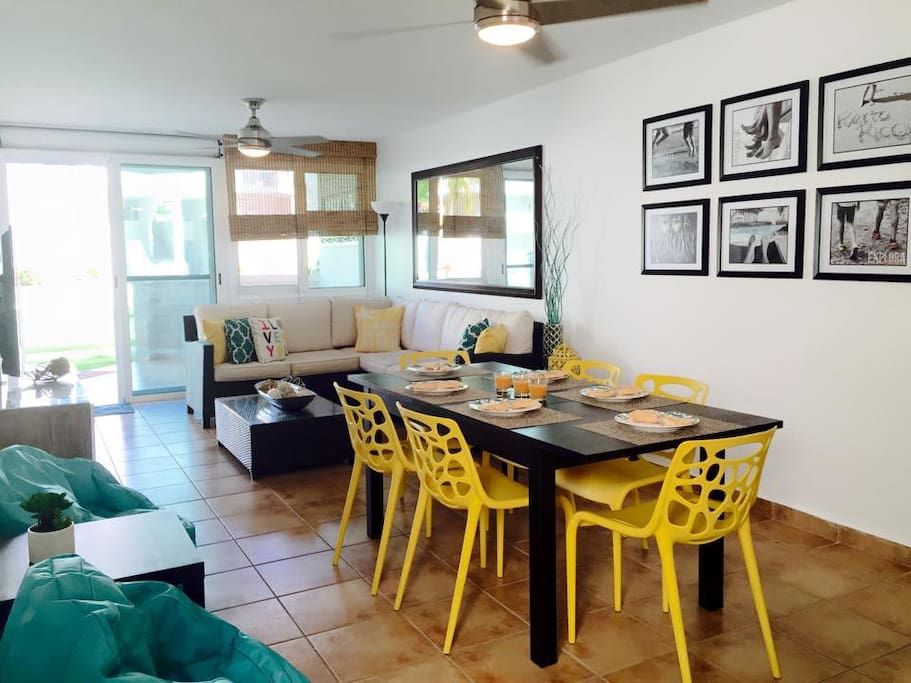 Comfortable, relax and nicely set up living and dining room with ac unit. Garden unit balcony gives you direct access to the pool, beach and all areas.