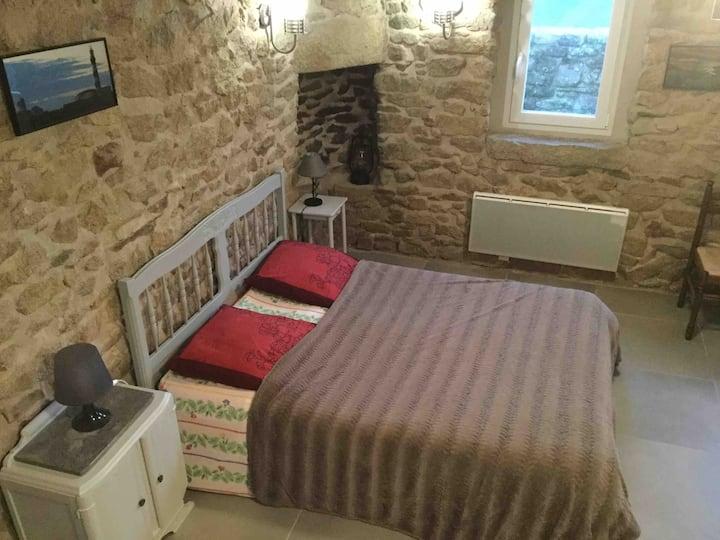 Belle chambre pierres apparentes