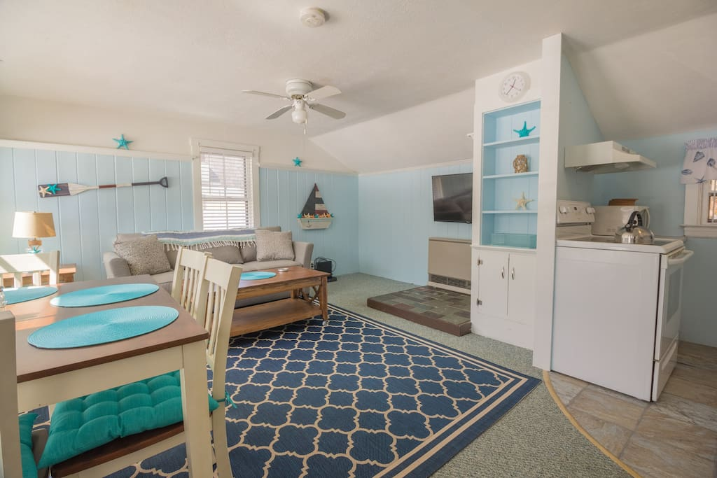 """A 48"""" wall-mounted flat screen TV and nautical décor adorn the living room"""