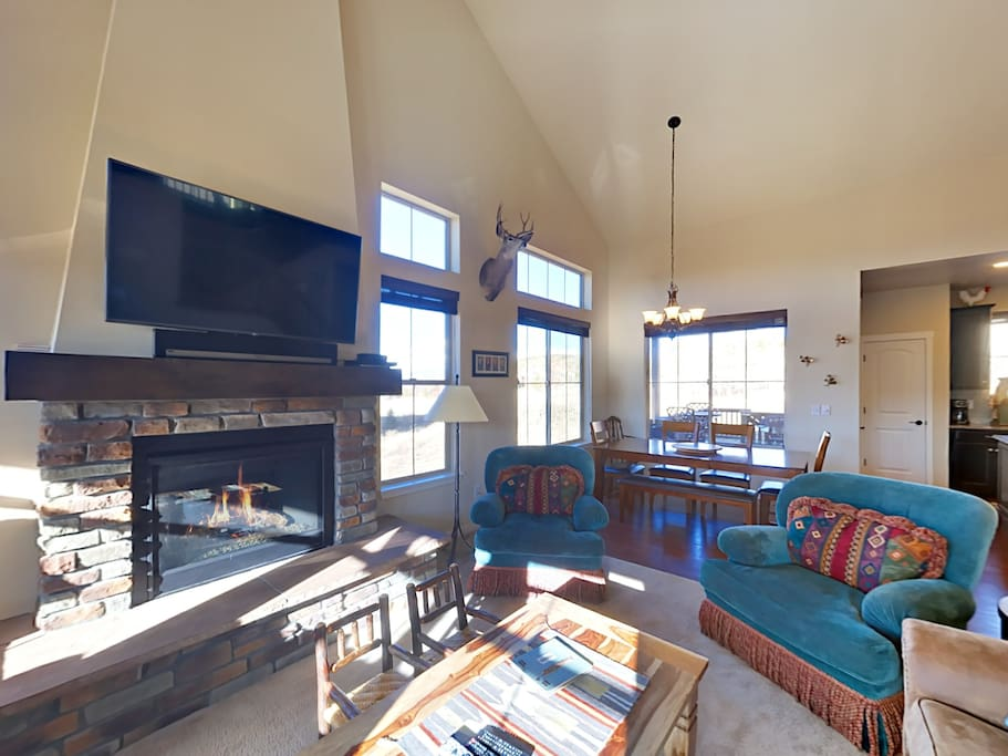 "Spacious living room with gas fireplace, 55"" TV, and Sonos sound system. Complimentary Wi-Fi is provided throughout."
