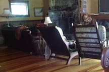 Fireplace, tv, leather coach, plenty of seating