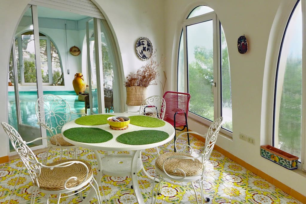 Dining room with sea views from all windows, designer tiles from Vietri.