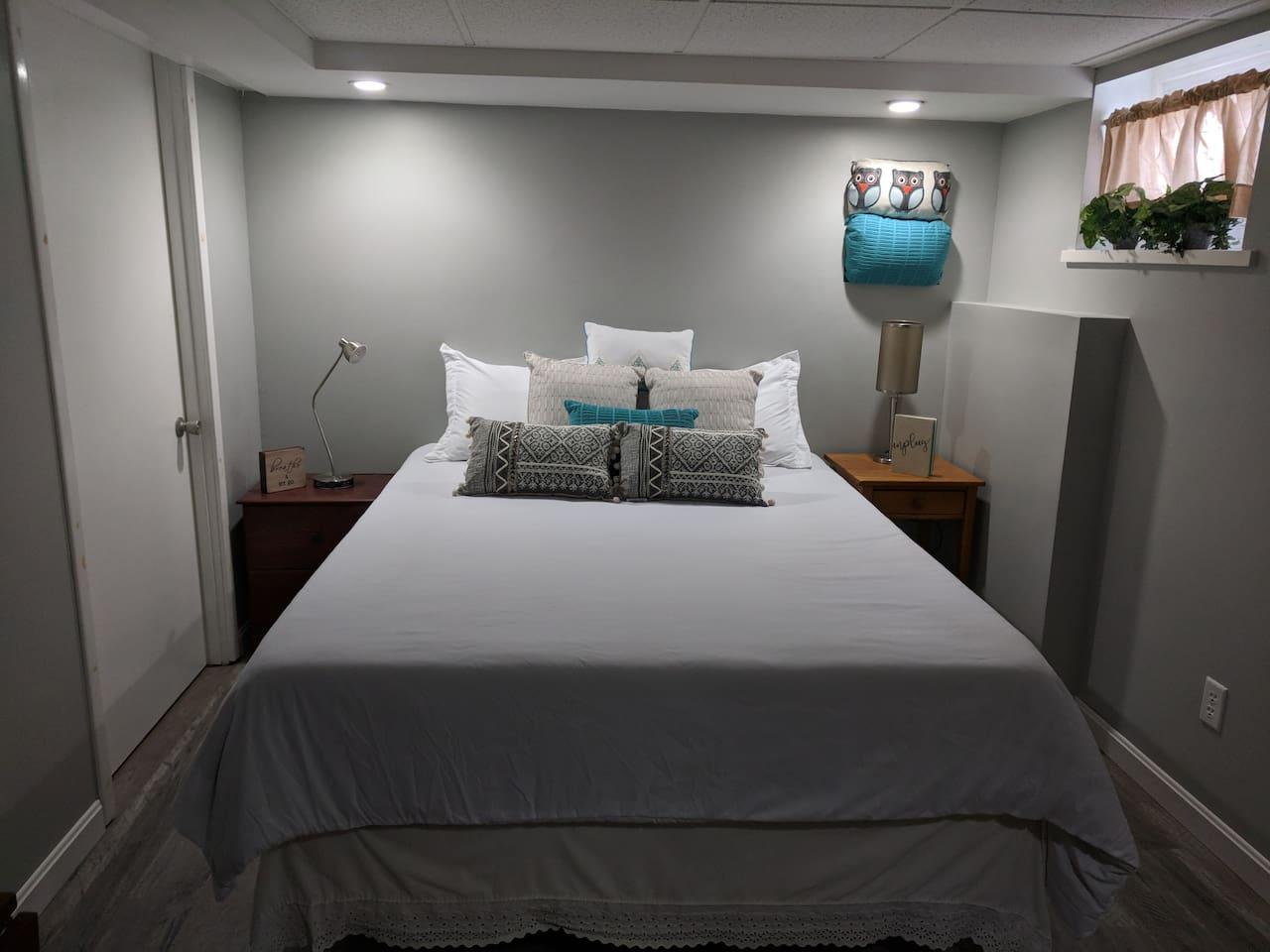 Cozy queen size bed.