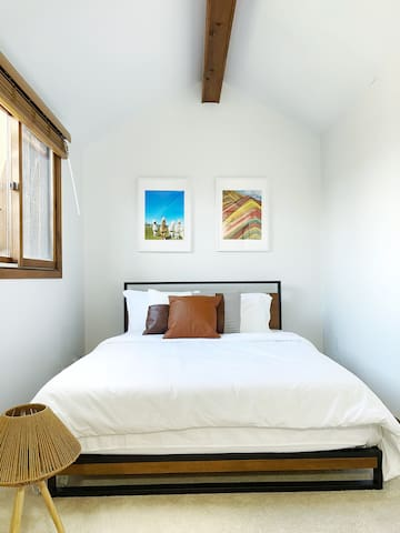 Our spacious 'Penthouse bedroom' is located on the third floor overseeing second floor.