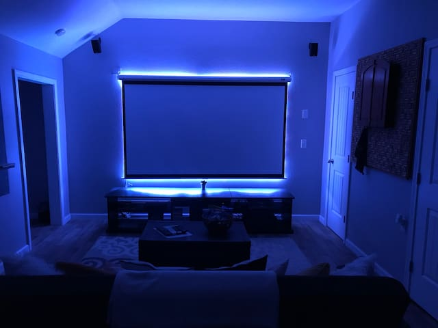Fun movie room lighting behind projector screen! Choose based on your mood or movie and control with remote.