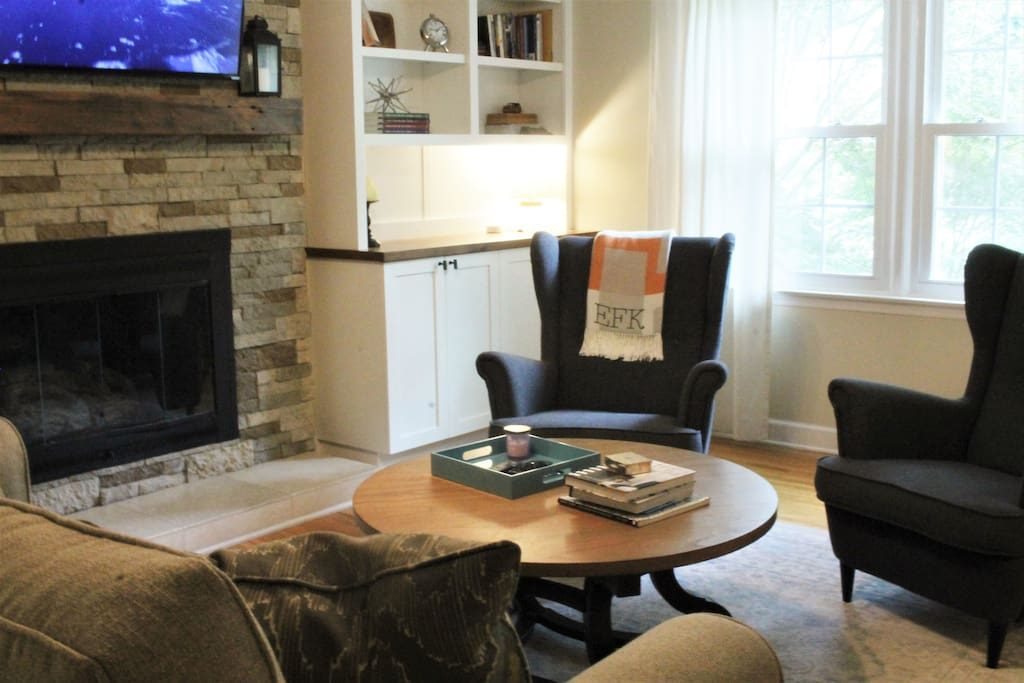 Den equipped with Apple TV, gas fireplace and ample seating.