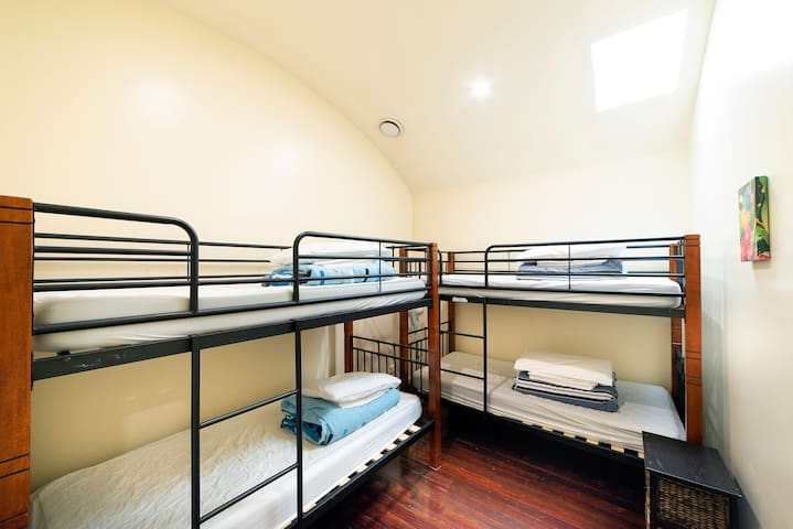 Upstairs bedroom with bunks - sleeps four