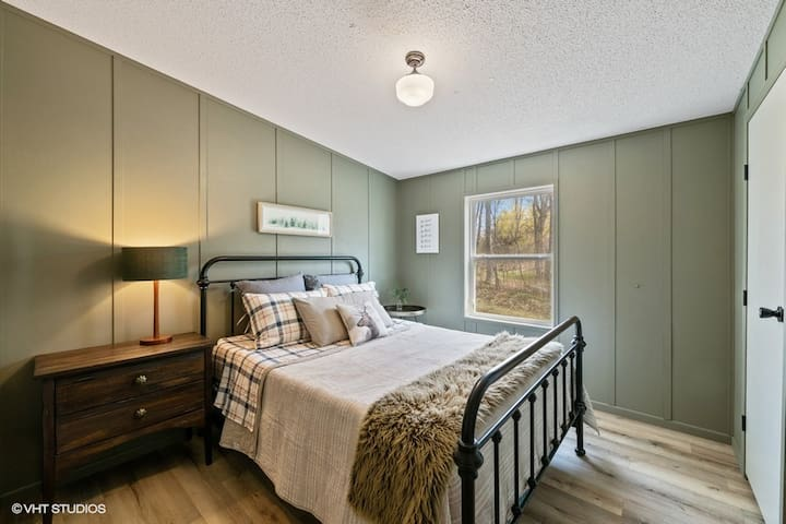 Bedroom Number 2 is equipped with a comfortable queen size bed.