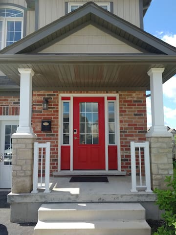 Front Door with access through digital door lock and traditional lock & key.