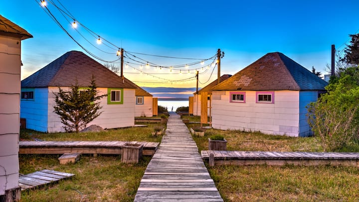 Renovated waterfront bungalow w/ kitchen, living room, expansive deck, steps from beach