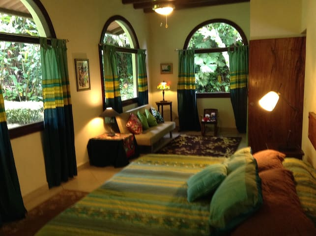 Guest bedroom with views to back yard offering a full private bathroom, king sized bed, closet and convertible couch .