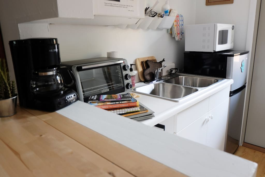 Kitchenette with eating area, mini-fridge, microwave, convection oven, and portable induction cooktop