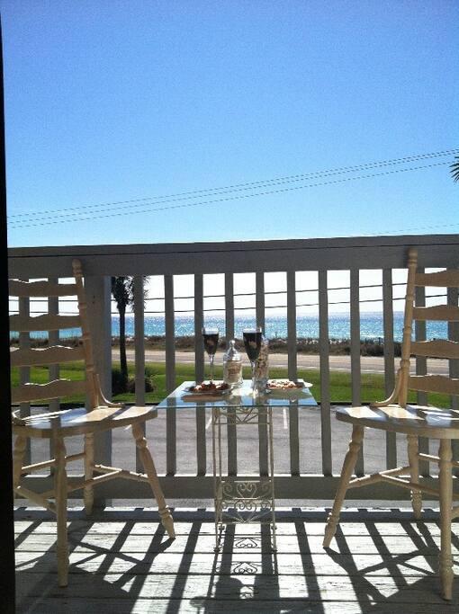 Enjoy breakfast on the balcony overlooking the beautiful beach
