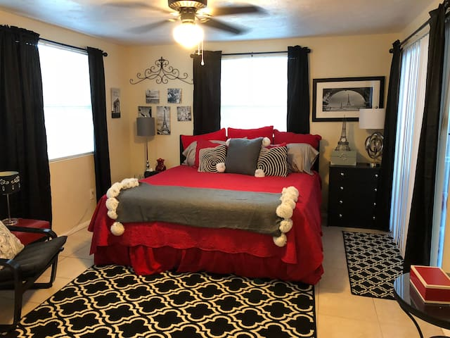 The bedroom has a king size bed, a walk-in closet, a walk out to the patio and a work space.