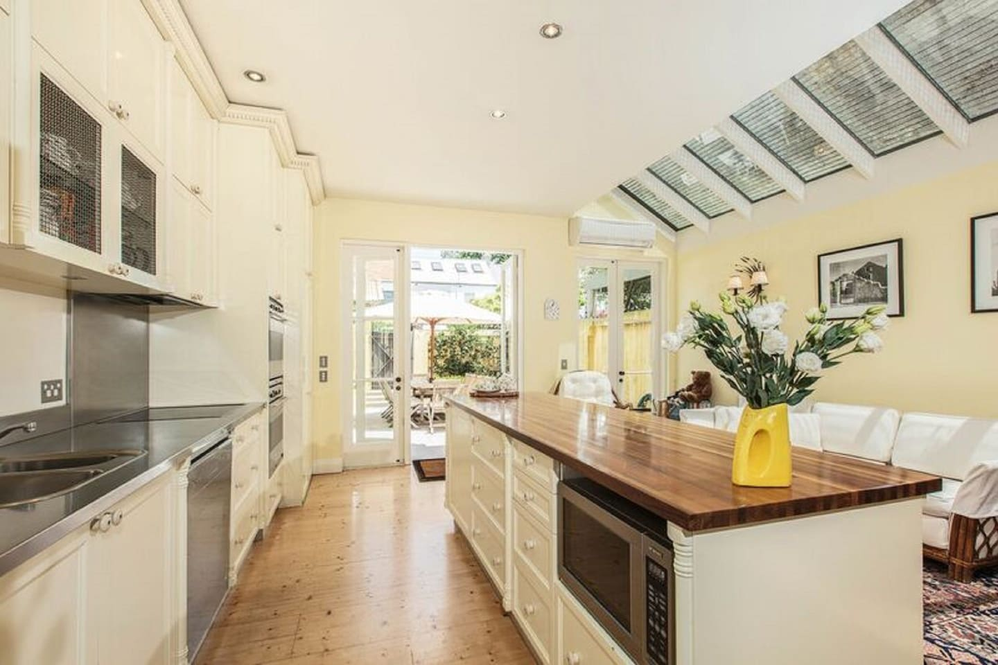 Immaculate kitchen offering gourmet appliances (incl d/washer) , large island bench & casual dining area