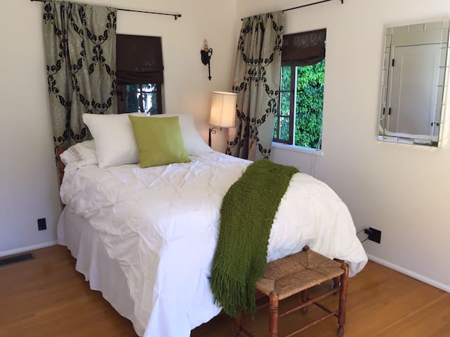 Comfortable bed with great sheets and a down comforter. Extra blankets in the closet.  This room also has French doors to the patio.