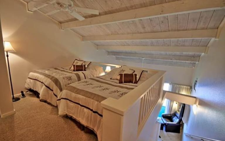 Loft style bedroom with two full beds