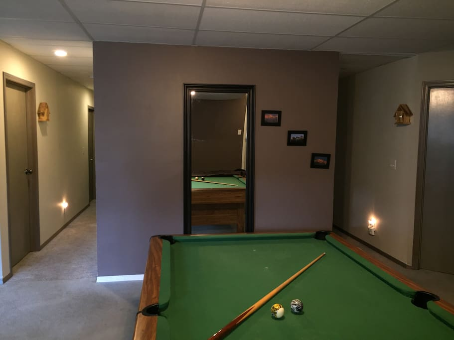 Living area with pool table in guest suite