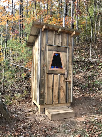 This is the tiny sawdust outhouse. A fresh clean bucket is provided just for you. The waste is burned and then used to grow flowers. You also have the option of coming down to the main house where you have private access to the bathroom and shower.