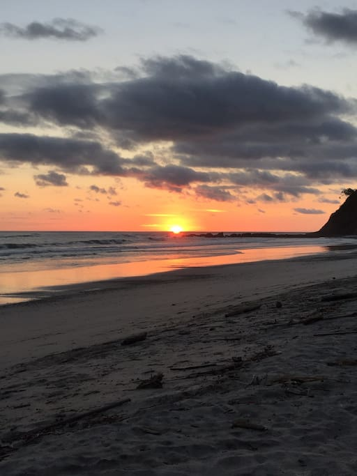 Enjoy sunsets from the beach that is 10 minutes walk from the house.