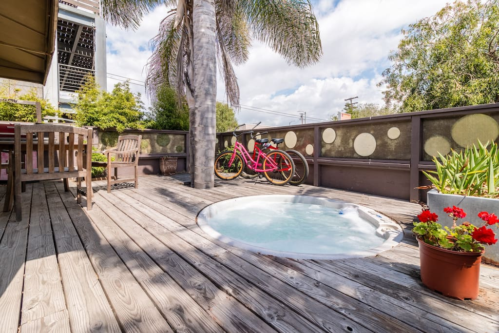 Your private deck with hot tub and outdoor dining area!