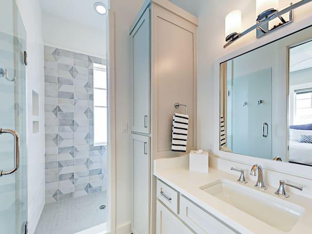 Stunning tile shower and plenty of storage in the en-suite 4th bathroom.