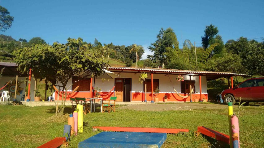 Outdoors and big comfortable rooms at La Tángara - Jardín - Hostel
