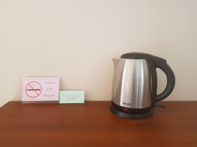 an electric kettle and Wifi username and password in each room