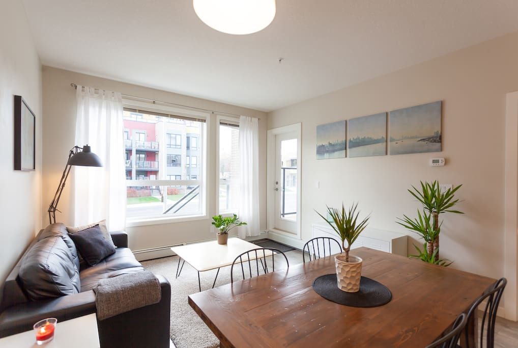 Big beautiful windows that look out onto the street. Direct access through the patio.