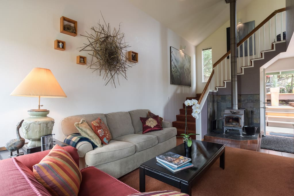 """The living room has 17 foot tall ceilings and an open staircase and it's very own bird nest.  The sofa expands to a queen sleeper with a 4""""memory foam mattress."""