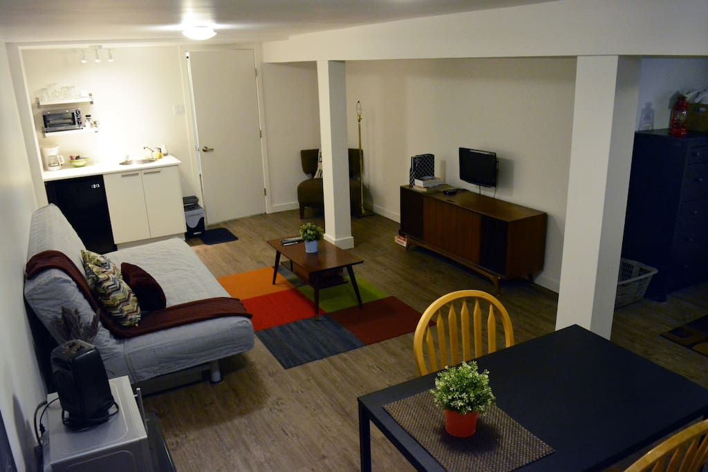 Dining space open to living room & kitchenette. The sofa bed can accommodate additional guests