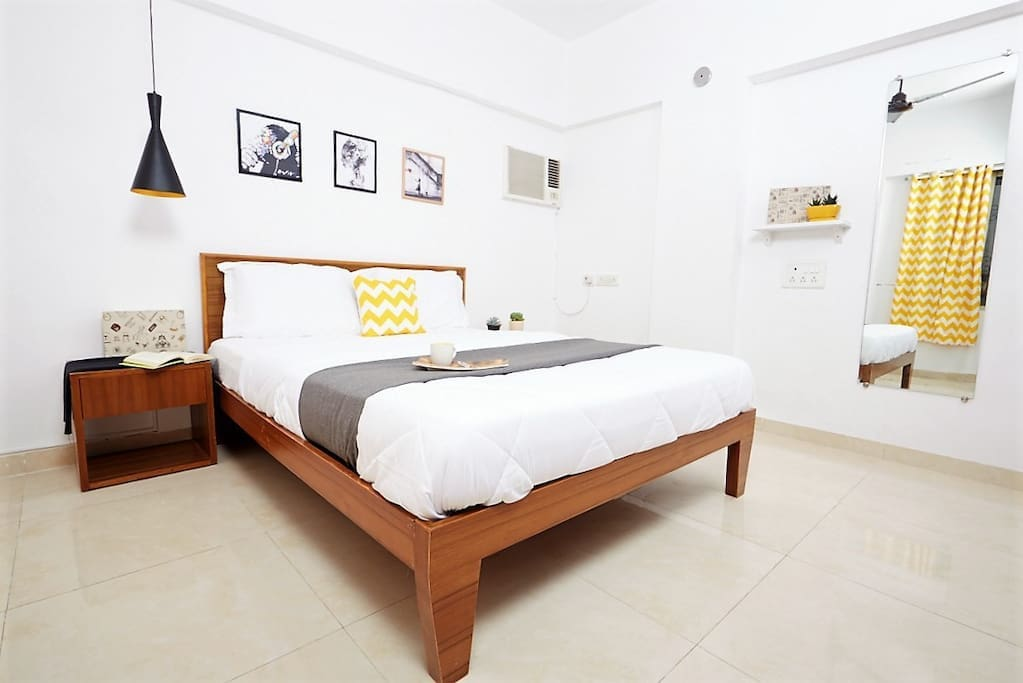 Room  with a sturdy Queen sized bed, Orthopedic mattresses and Dr. Back pillows for an incredibly restful sleeping experience.