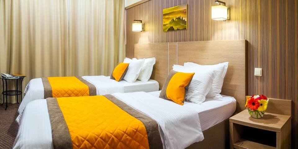 Улучшенный двухместный с одной большой или двумя отдельными кроватями в Comfort Nsk Hotel