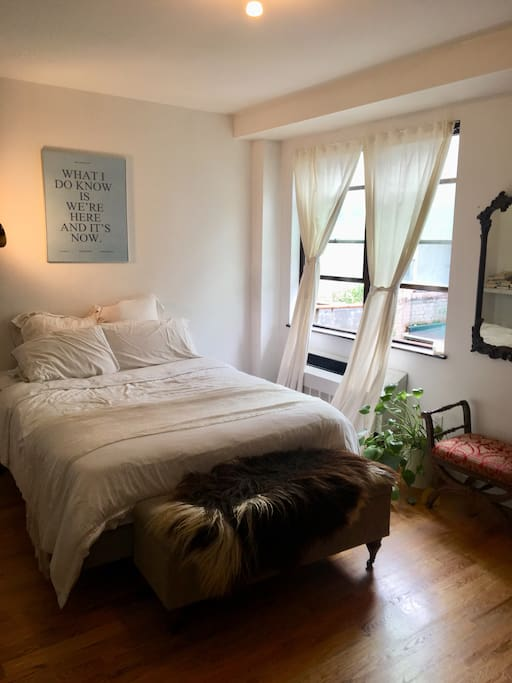 Airy, bright and large bedroom with queen sized bed and big windows flooded with light
