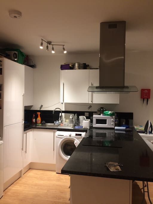 Large open kitchen with washing machine and dryer