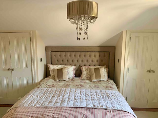 Master bedroom with fitted wardrobe and superking bed.